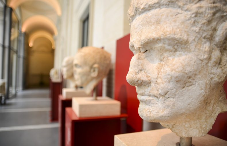 Close up of classical Roman busts in a gallery, Rome, Italy.